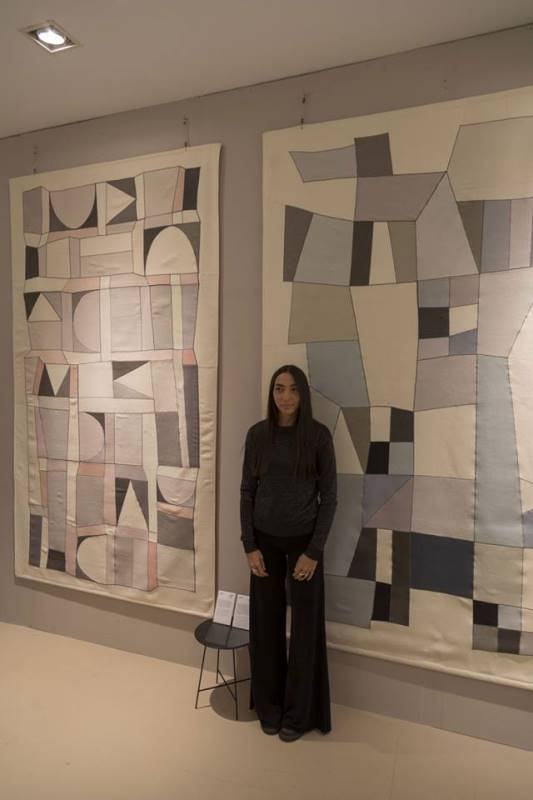 Alizarina Silva in front of her fabric panels in Rinascente
